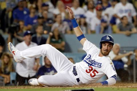 Los Angeles Dodgers' Cody Bellinger (35) scores against the Los Angeles Angels during a basebal ...