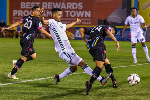 Las Vegas Lights FC forward Jose Villarreal (24, right) sends a kick into the net with Portland ...