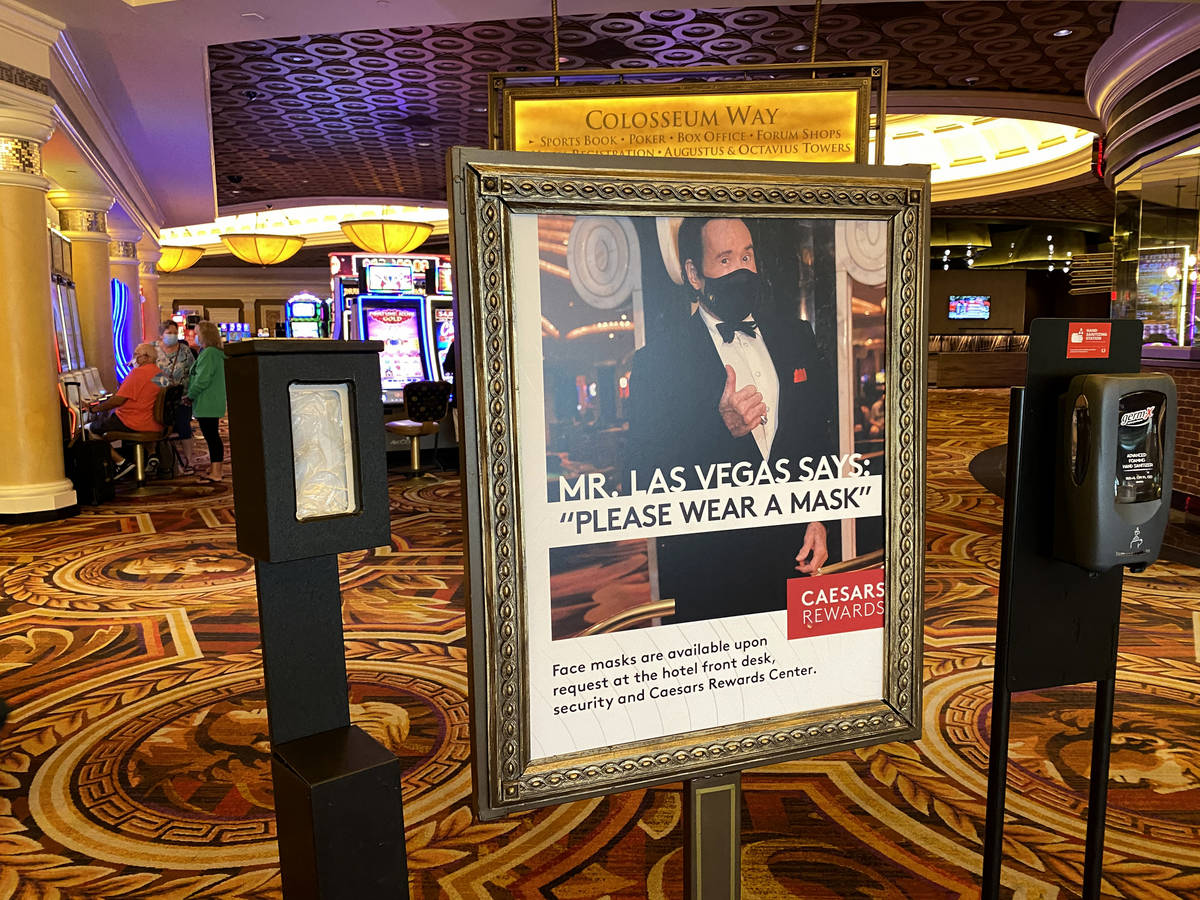 Mr. Las Vegas Wayne Newton appears in a reminder to wear face masks at Caesars on the Strip in ...