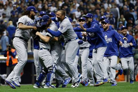 The Los Angeles Dodgers celebrate after Game 7 of the National League Championship Series baseb ...