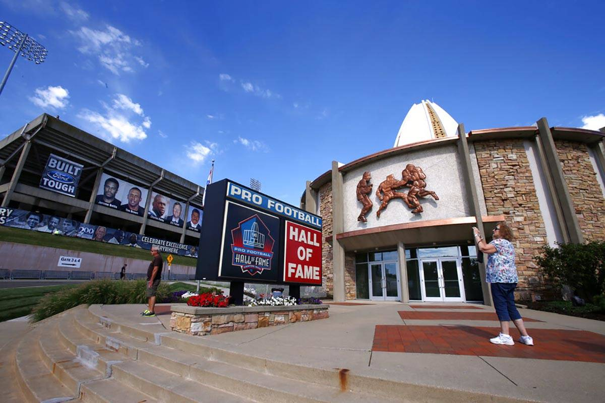 In this Aug. 7, 2015, file photo, a visitor to the Pro Football Hall of Fame pauses to take a p ...
