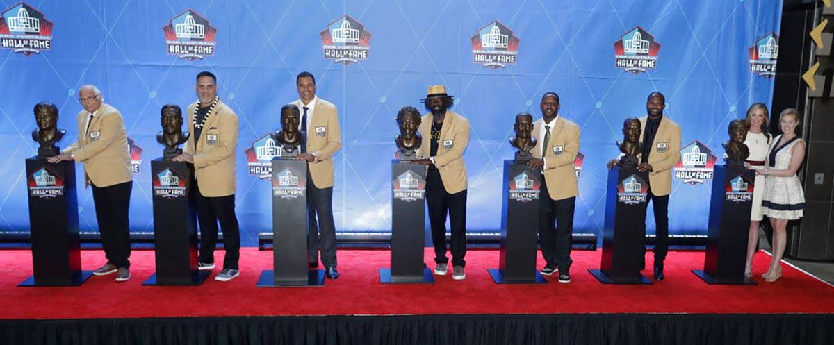 FILE - In this Aug. 4, 2019, file photo, NFL inductees and family members pose with busts durin ...