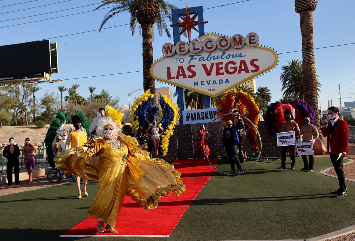 Jim McCoy as Auntie Norma, walks the red carpet at the Welcome to Fabulous Las Vegas sign on th ...