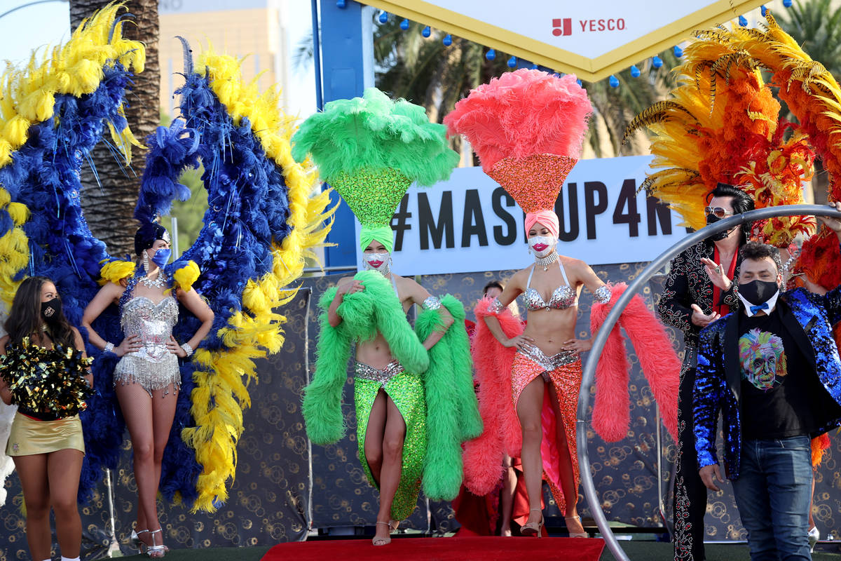 Showgirls walk the red carpet at the Welcome to Fabulous Las Vegas sign on the south Strip in L ...