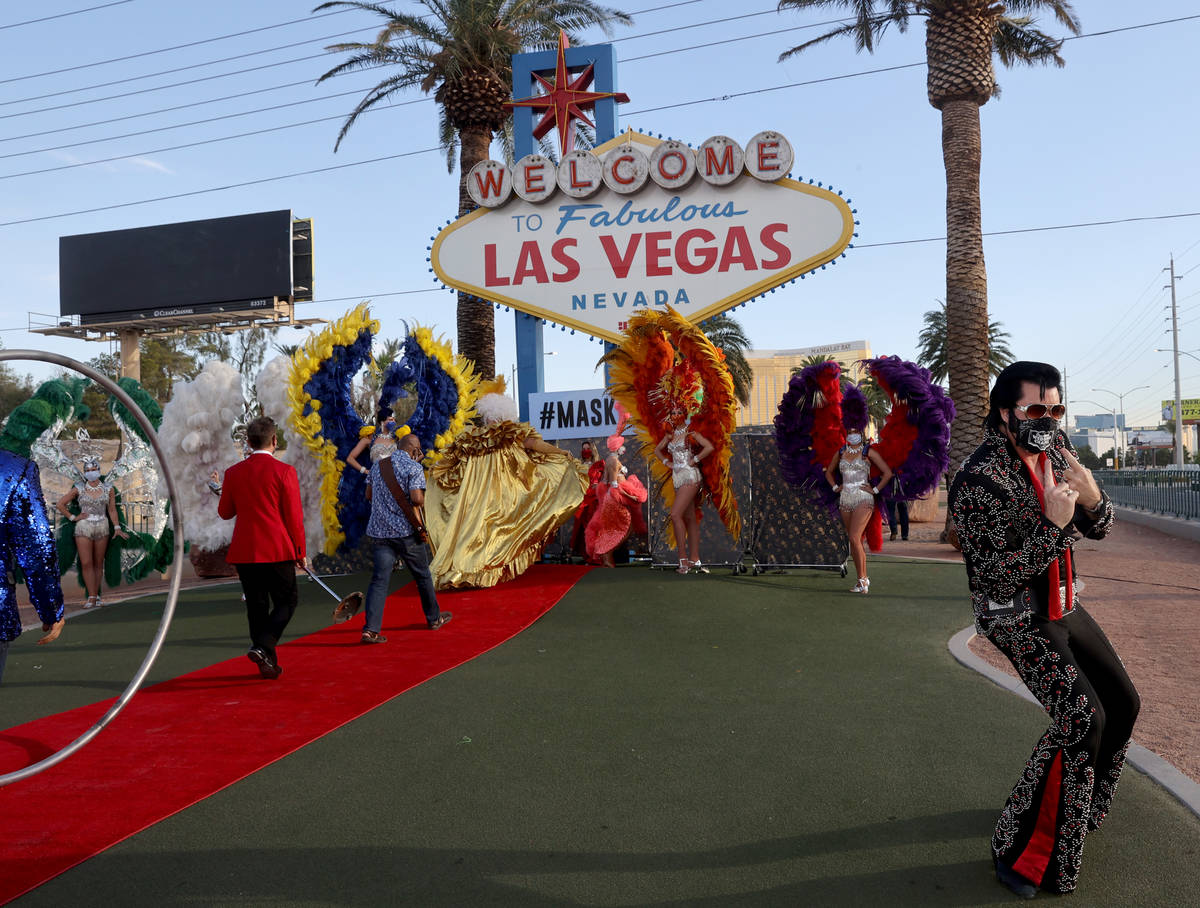 Elvis Impersonator Brendan Paul poses at the Welcome to Fabulous Las Vegas sign on the south St ...