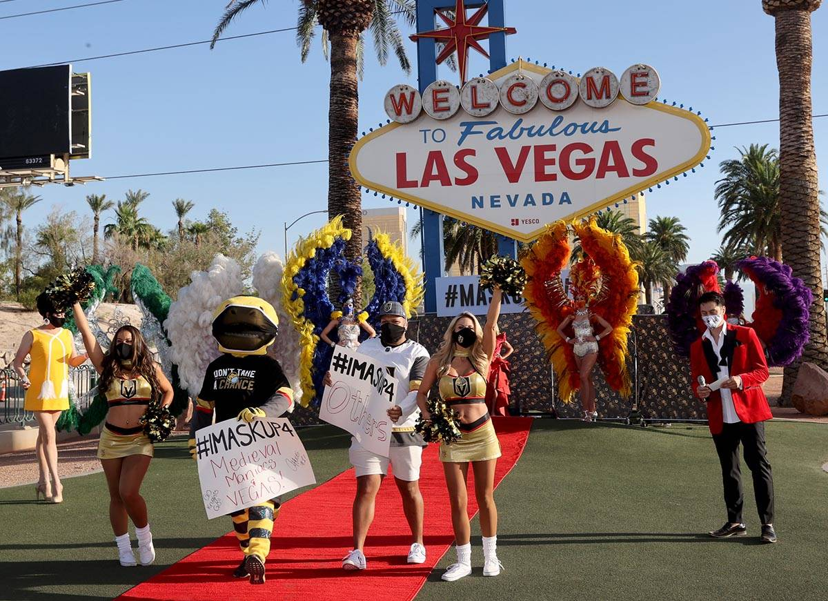 """Vegas Golden Knights mascot, Chance, Anthem singer Carnell """"Golden Pipes"""" Johnson and ..."""