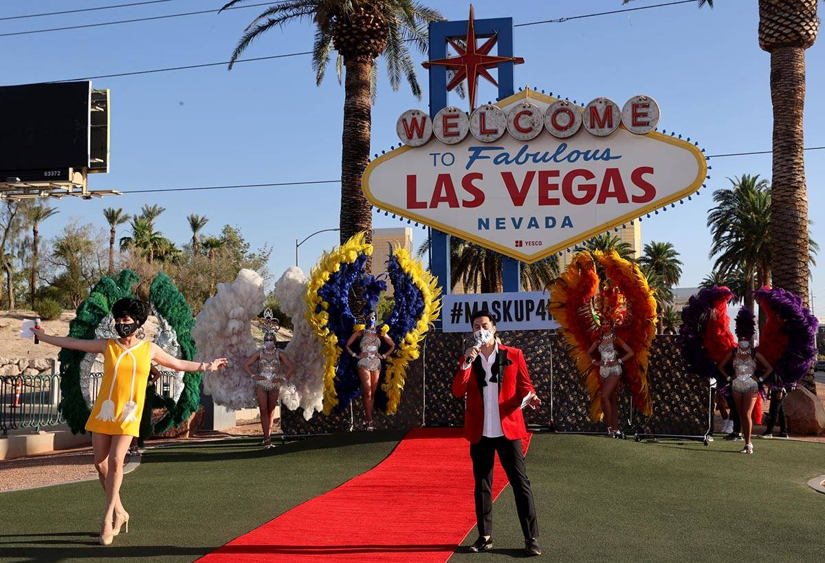 Edie from Zumanity by Cirque du Soleil and host Bryan Chan walk the red carpet at the Welcome t ...