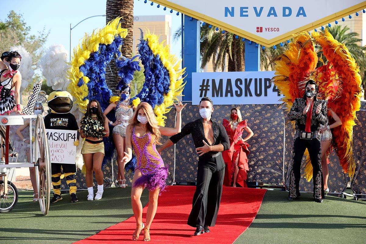 "Ballroom dancers Sarah LeClear and husband Alejandro Domingo ""walk"" the red carpet at ..."