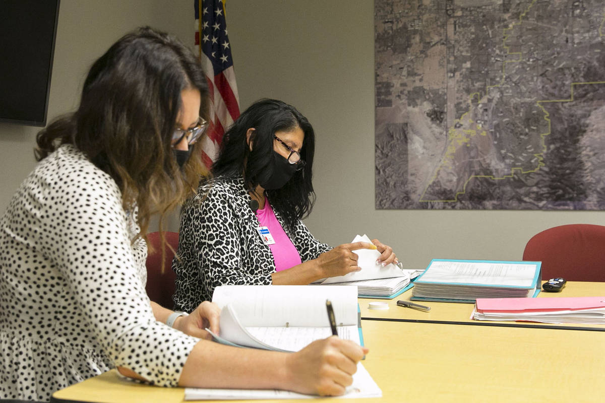 Maria Aguirre, left, Election and Administration Service supervisor, and Sabrina Mercadante, th ...