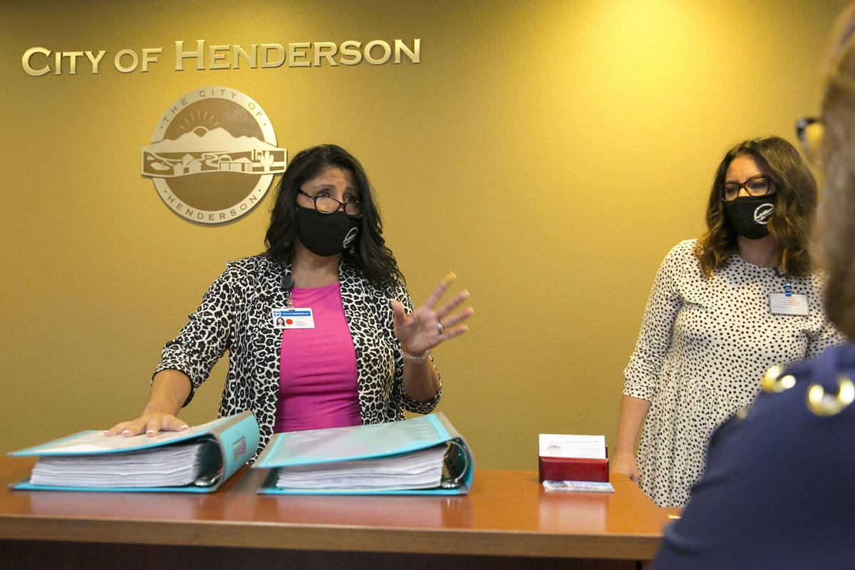 Sabrina Mercadante, the City of Henderson clerk, speaks to Laura Sanchez, right, after receivi ...