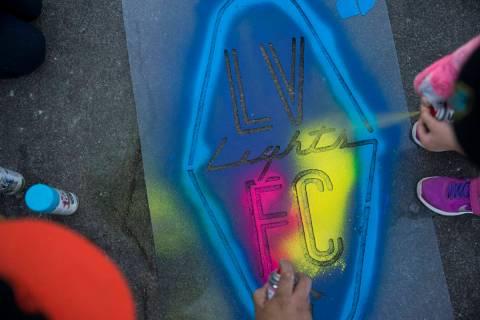 A Las Vegas Lights FC logo is sprayed on the ground outside of Cashman Field in Las Vegas, Satu ...