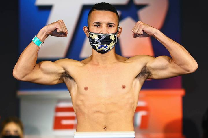 Orlando Gonzalez-Ruiz weighs in Wednesday for his featherweight fight against Luis Porozo on Th ...