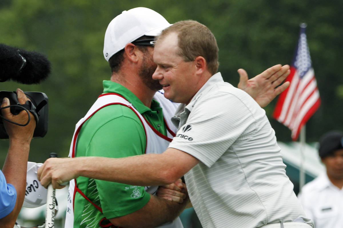 Ted Potter Jr. hugs his caddie as he celebrates winning the Greenbrier Classic PGA Golf tournam ...