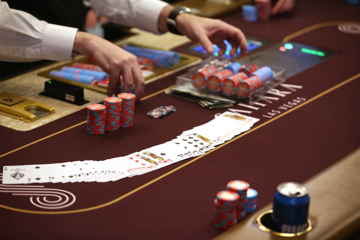 Poker chips are collected at Sahara Las Vegas casino-hotel in Las Vegas in February 2020. (Erik ...
