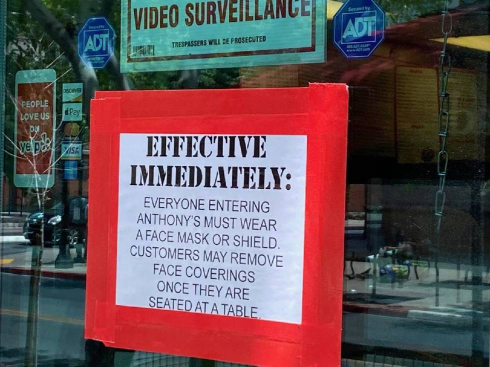 A sign at Anthony's in downtown Las Vegas reminds customers that face masks are required to ent ...