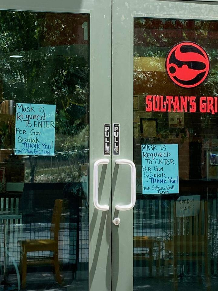Signs at Sultan's Grill in downtown Las Vegas remind customers of Nevada's mask mandate (David ...