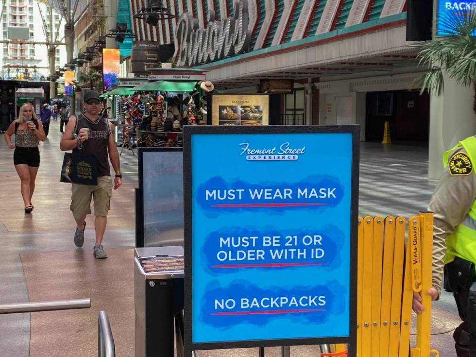 A sign at Fremont Street Experience in downtown Las Vegas reminds guests that masks are require ...
