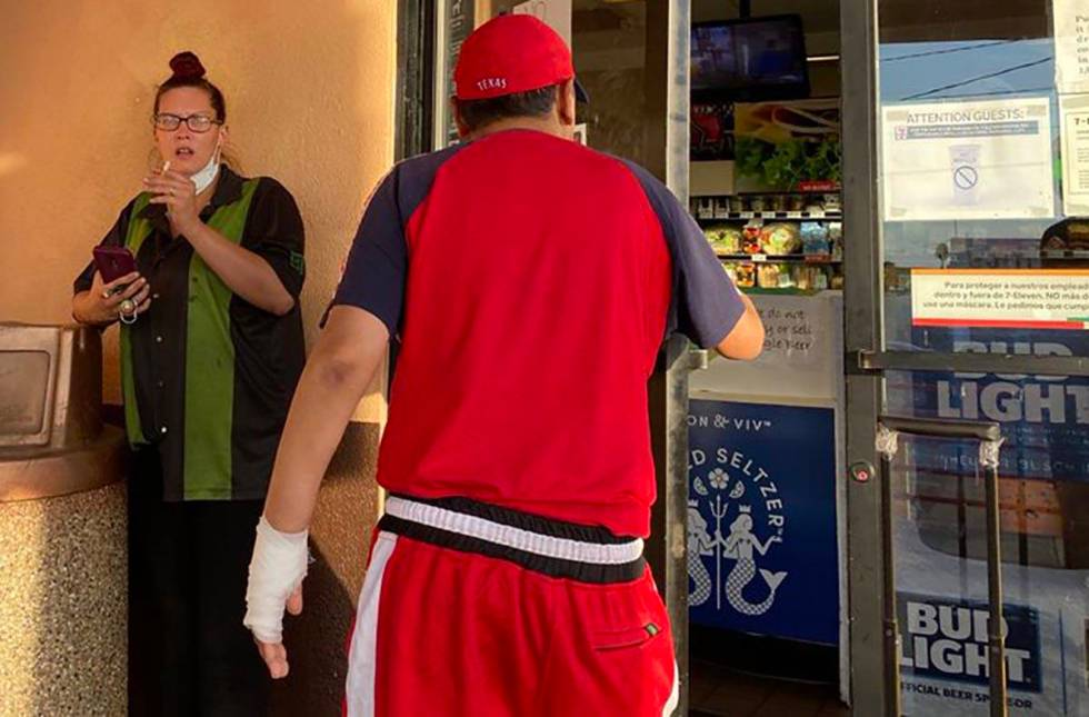 A clerk on a smoke break at a 7-Eleven store at Las Vegas Boulevard and Stewart Avenue tells an ...
