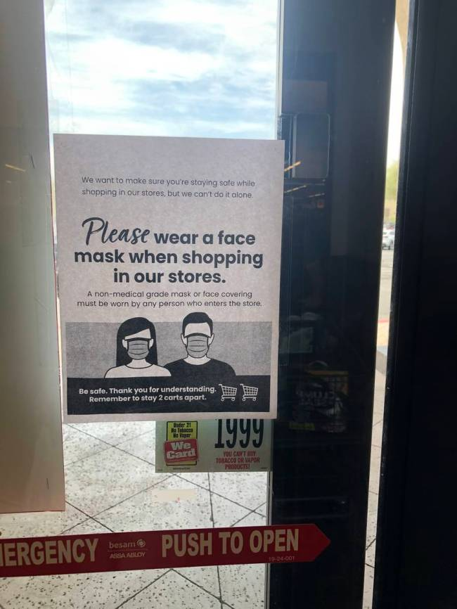 A sign posted at Albertsons at W. Charleston Blvd. and Desert Foothills Dr. reminded shoppers t ...