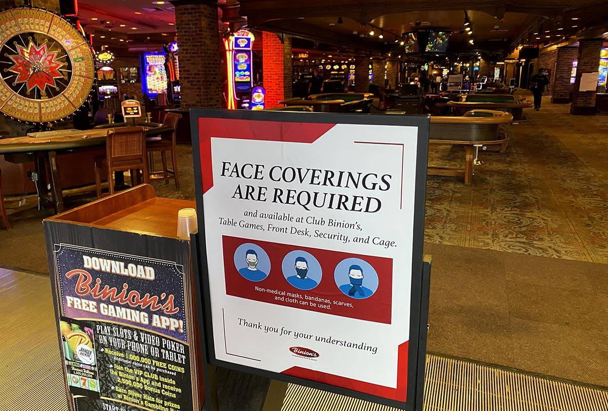 A sign notifying guests of face covering requirement at Binion's in downtown Las Vegas on Frida ...