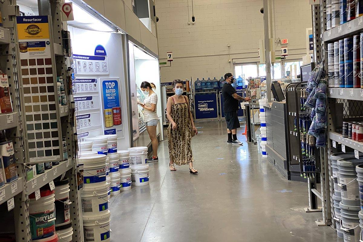 Shoppers don face masks while shopping at Lowe's on East Charleston Boulevard near Fremont Stre ...