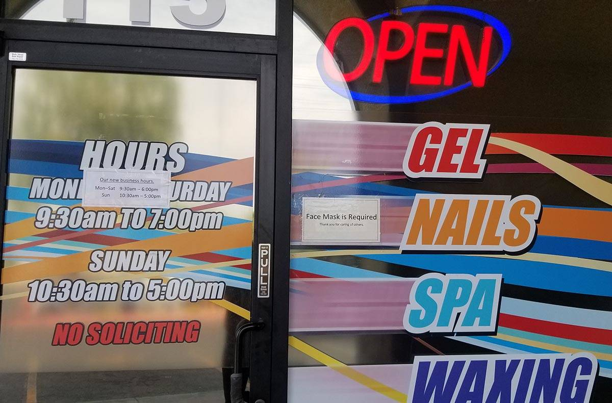 A sign warns patrons not to enter a store at Southwest Marketplace, off Rainbow Boulevard betwe ...