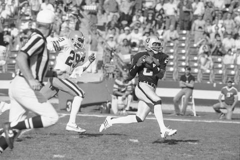 FILE - In this Jan. 8, 1983, file photo Los Angeles Raiders wide receiver Cliff Branch, right, ...