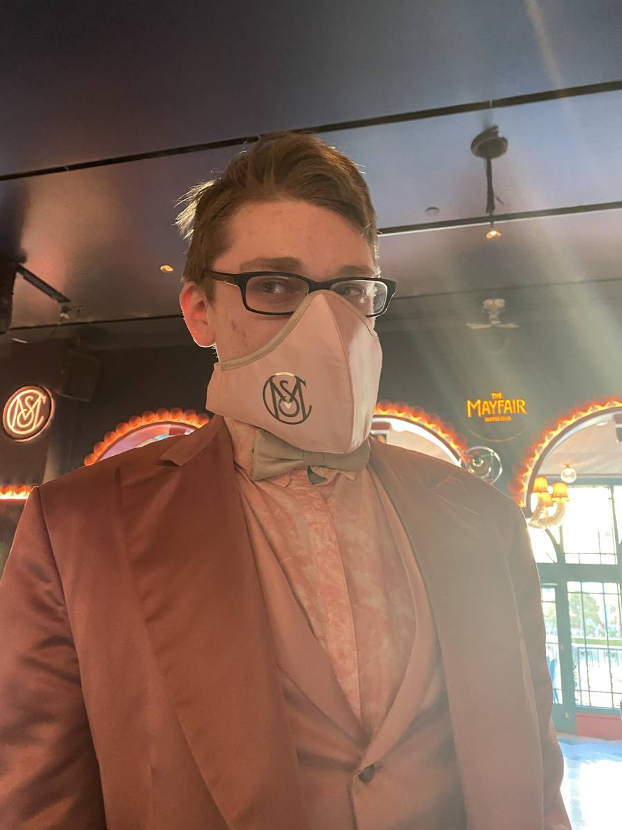 Mayfair Supper Club pianist Patrick Hotan is shown in his club-branded mask on Thursday, June 4 ...