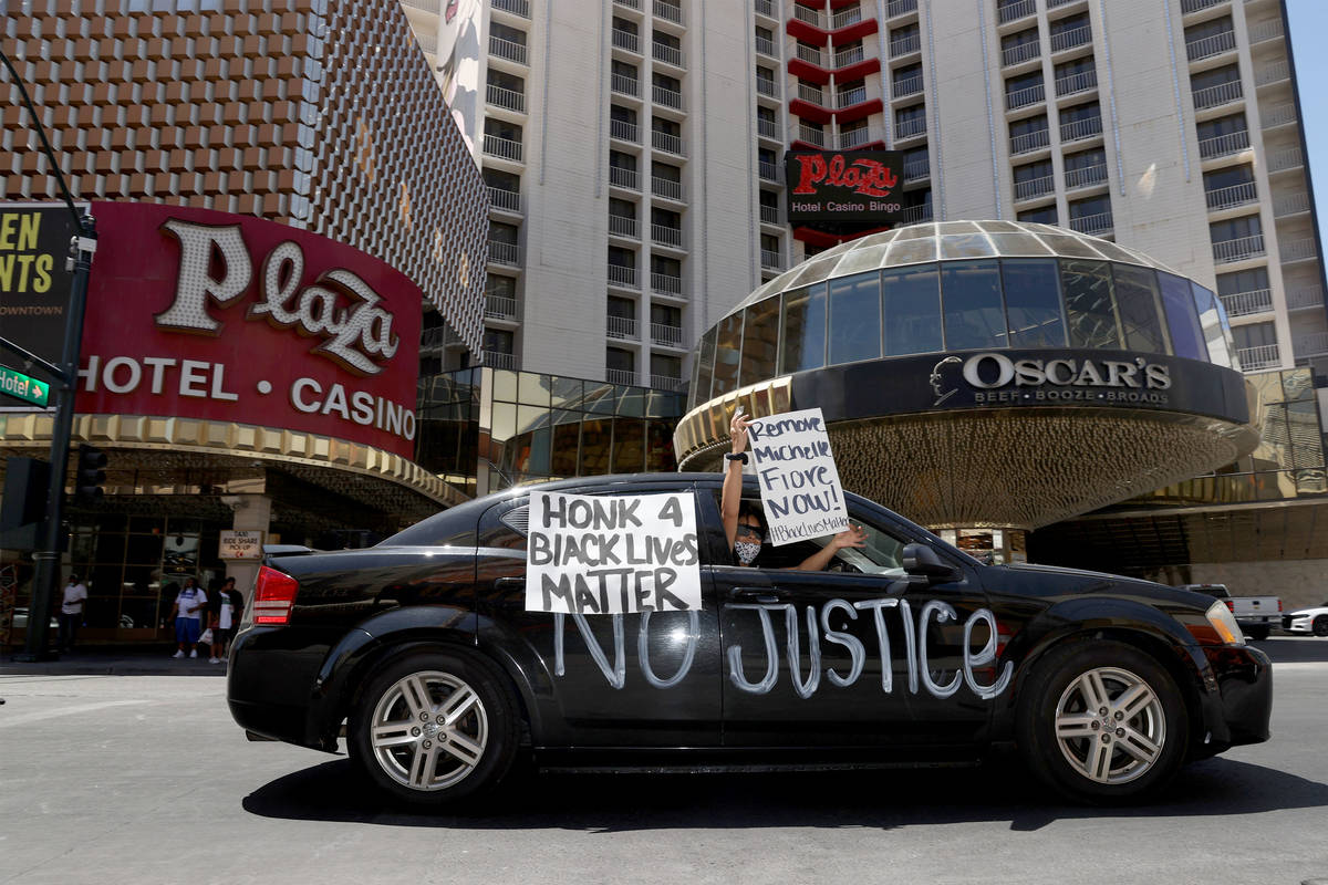 People participate in a Black Lives Matter parade near the intersection of Main Street an Fremo ...