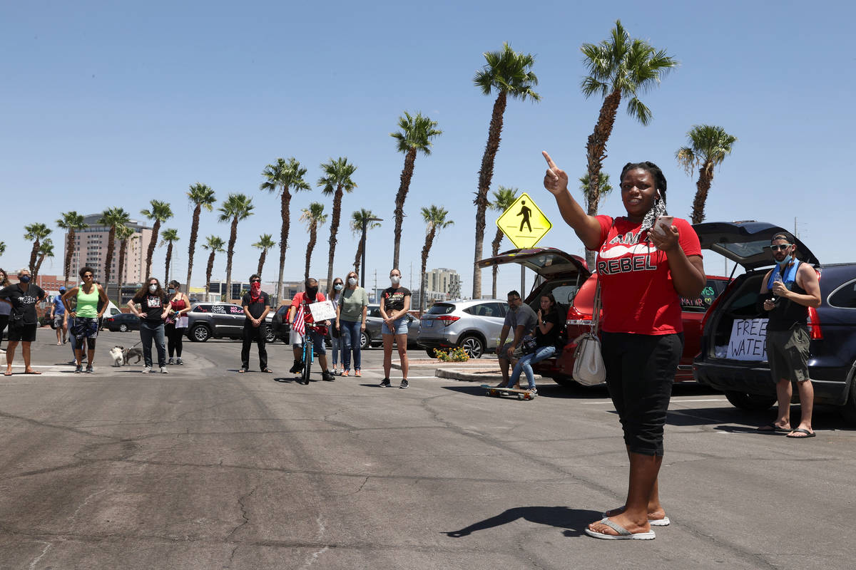 Tia Coward, event organizer and Las Vegas resident, gives instructions to people in advance of ...