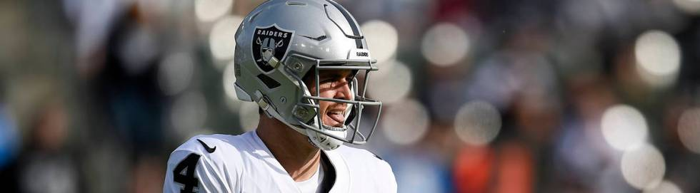 Oakland Raiders quarterback Derek Carr in action during the first half of an NFL football game ...