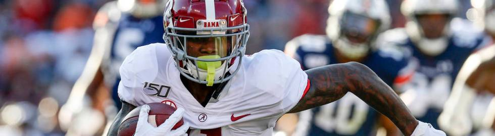 Alabama wide receiver Henry Ruggs III (11) carries the ball after a reception against Auburn du ...