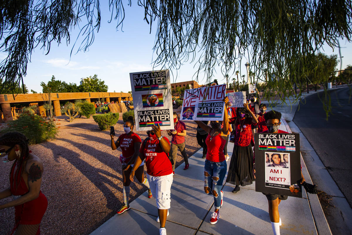 People participate in a silent solidarity march in support of Black Lives Matter and the Stonew ...