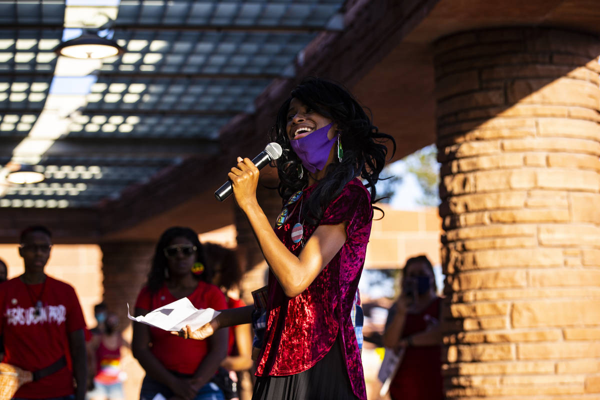 Chrystal McKinley speaks before a silent solidarity march in support of Black Lives Matter and ...
