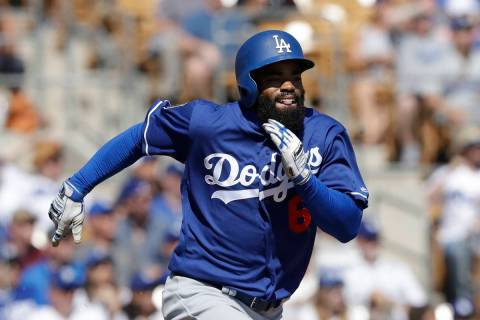 Los Angeles Dodgers' Andrew Toles runs to first during the second nning of a spring training ba ...