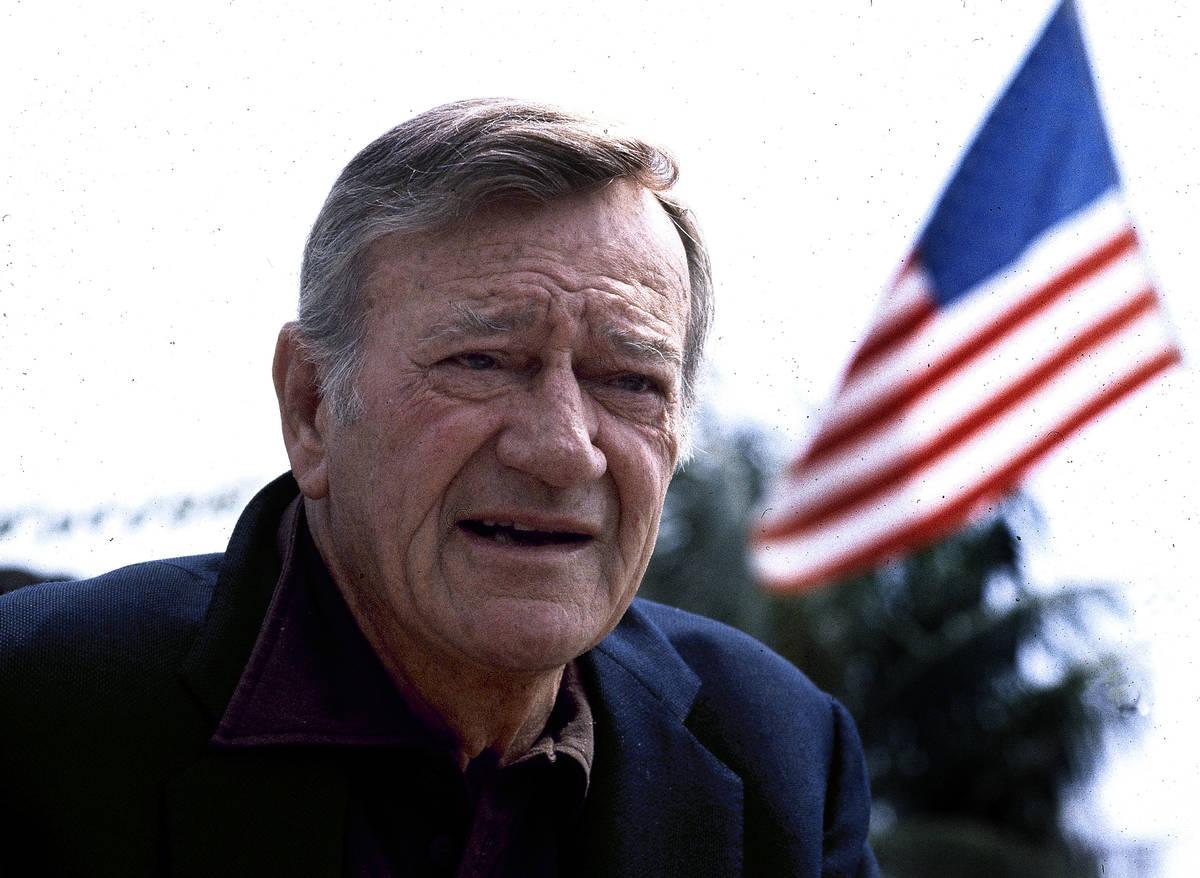 FILE - This 1978 file photo shows actor John Wayne. Wearing a brown plaid coat worn by Wayne in ...