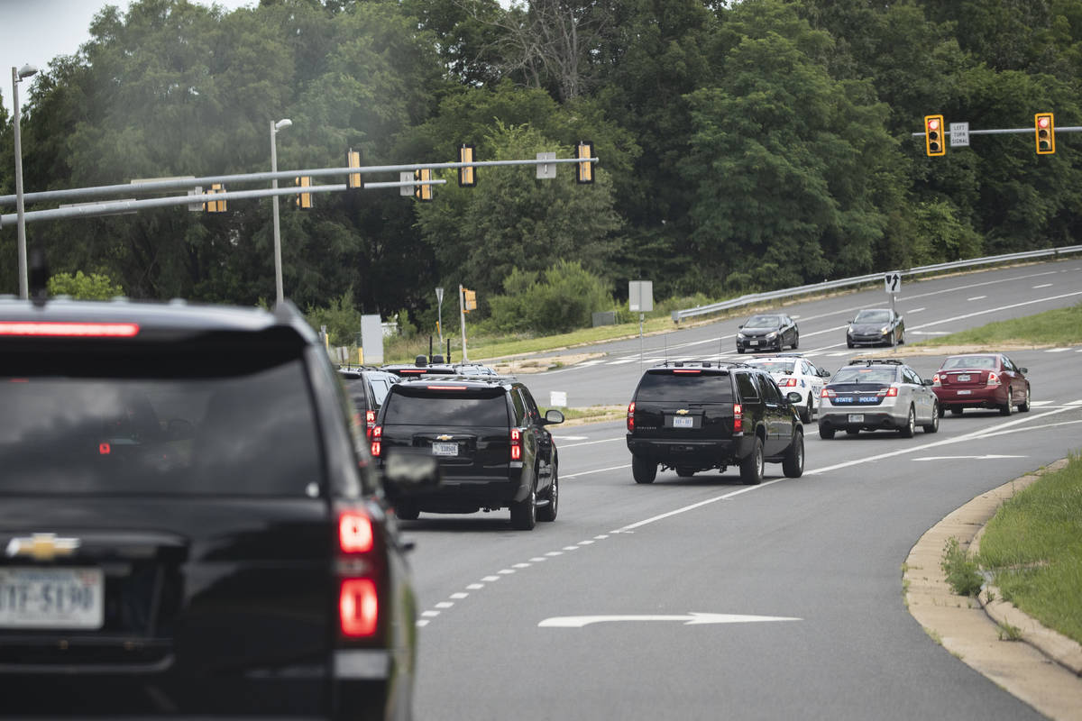 The motorcade for President Donald Trump travels en route to Trump National Golf Club, Sunday, ...