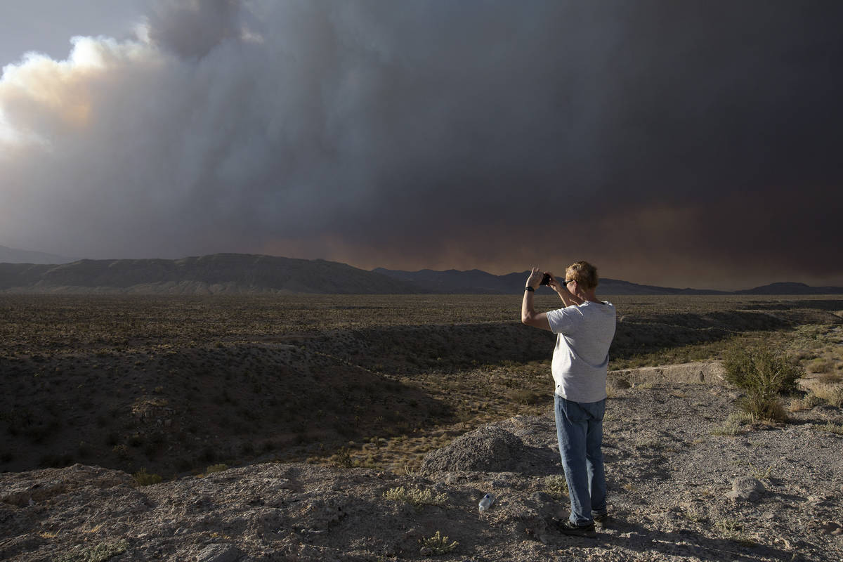 Chris Newcomer takes a photo of the Mahogany Fire on his way home from hiking Cathedral Rock at ...