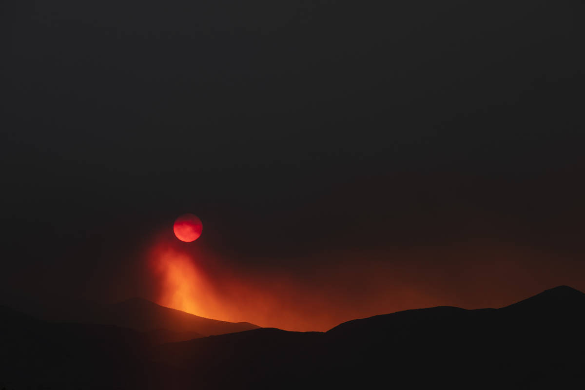 Smoke from the Mahogany Fire dims the sun as it sets at Mount Charleston on Sunday, June 28, 20 ...