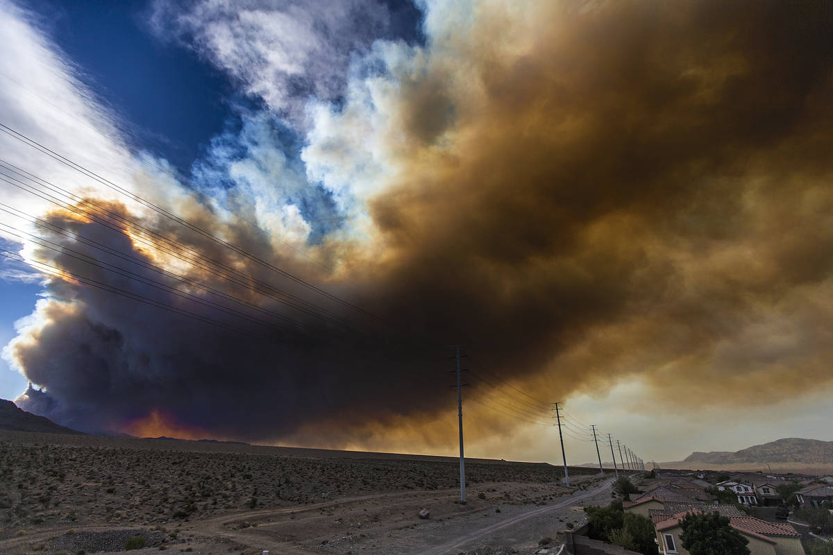 Smoke from a wildfire at Mount Charleston moves across the northwest valley on Sunday, June 28, ...