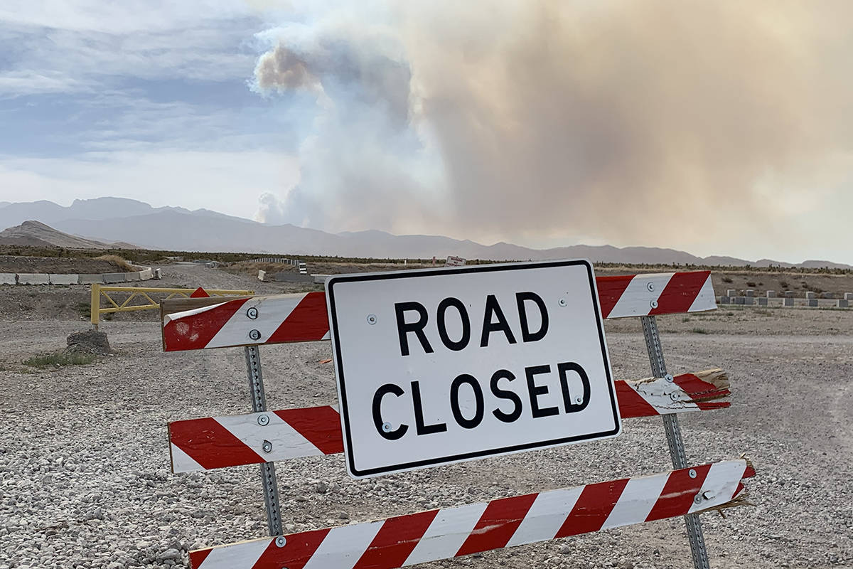 Smokes rises near Mount Charleston seen from West Grand Teton Drive on Sunday, June 28, 2020, i ...