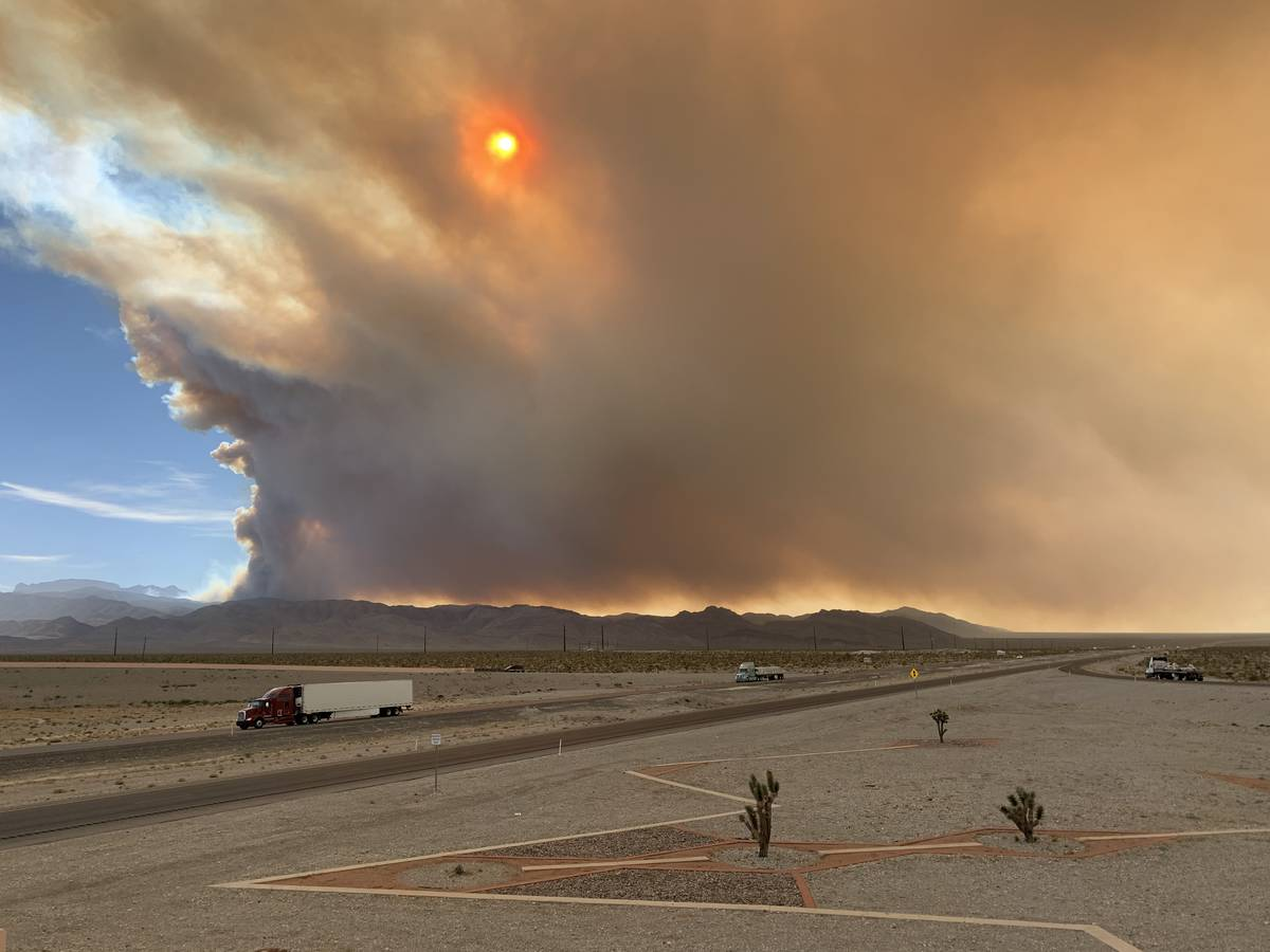 Smoke is seen from Snow Mountain overpass and U.S. Highway 95 North on Sunday, June 28, 2020, i ...
