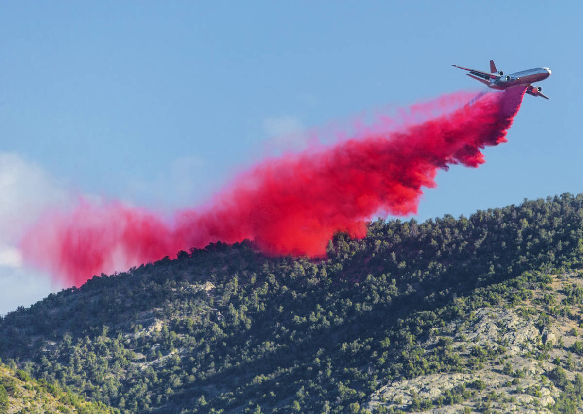 An air tanker drops fire retardant while fighting the Mahogany Fire on Mount Charleston on Mon ...