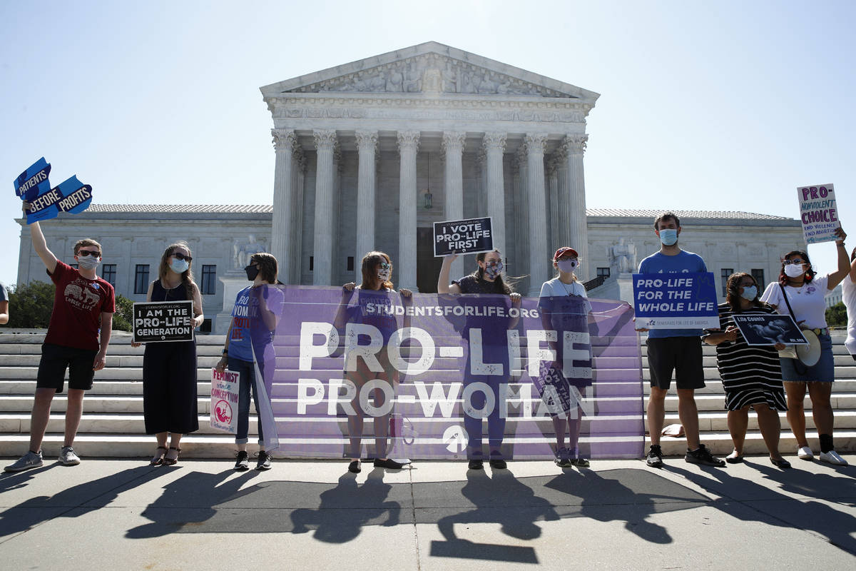 Anti-abortion protesters wait outside the Supreme Court for a decision, Monday, June 29, 2020 i ...