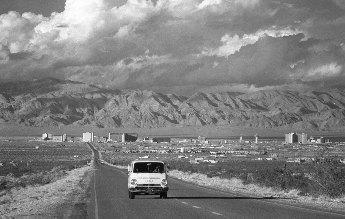 Shots of clouds above the Las Vegas skyline. Weatherman is predicting rain. In paper 1-16-1980.