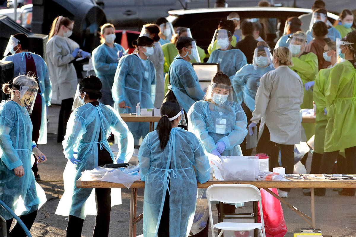 In this photo taken Saturday, June 27, 2020, medical personnel prepare to test hundreds of peop ...