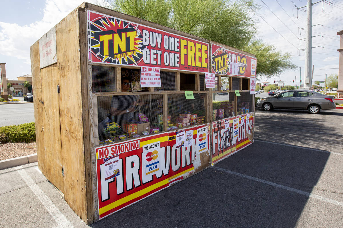 Floyd Ellis looks out of the fireworks booth for Freedom House Sober Living in the Albertsons p ...