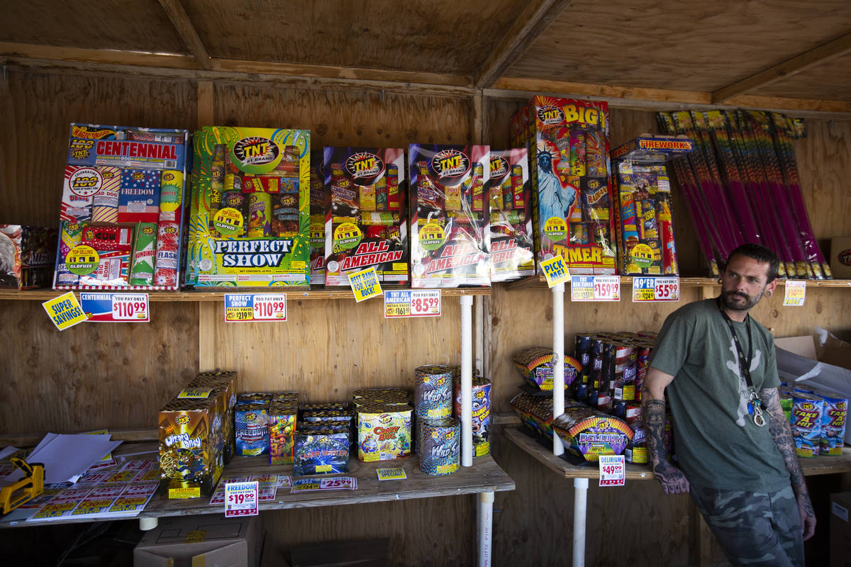 Jeremiah Wicker sits inside the fireworks booth for Freedom House Sober Living in Las Vegas on ...