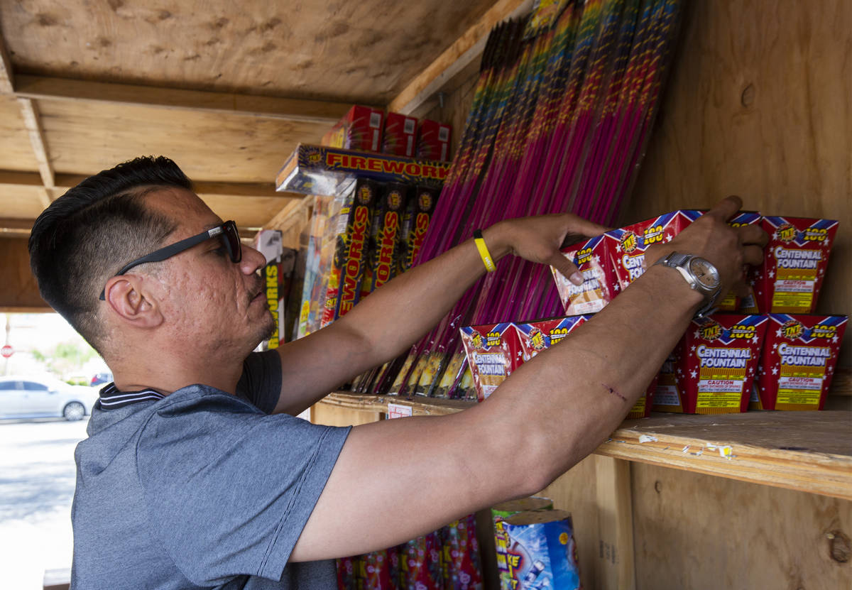 Floyd Ellis organizes fireworks on the top shelf of the fireworks booth for Freedom House Sober ...