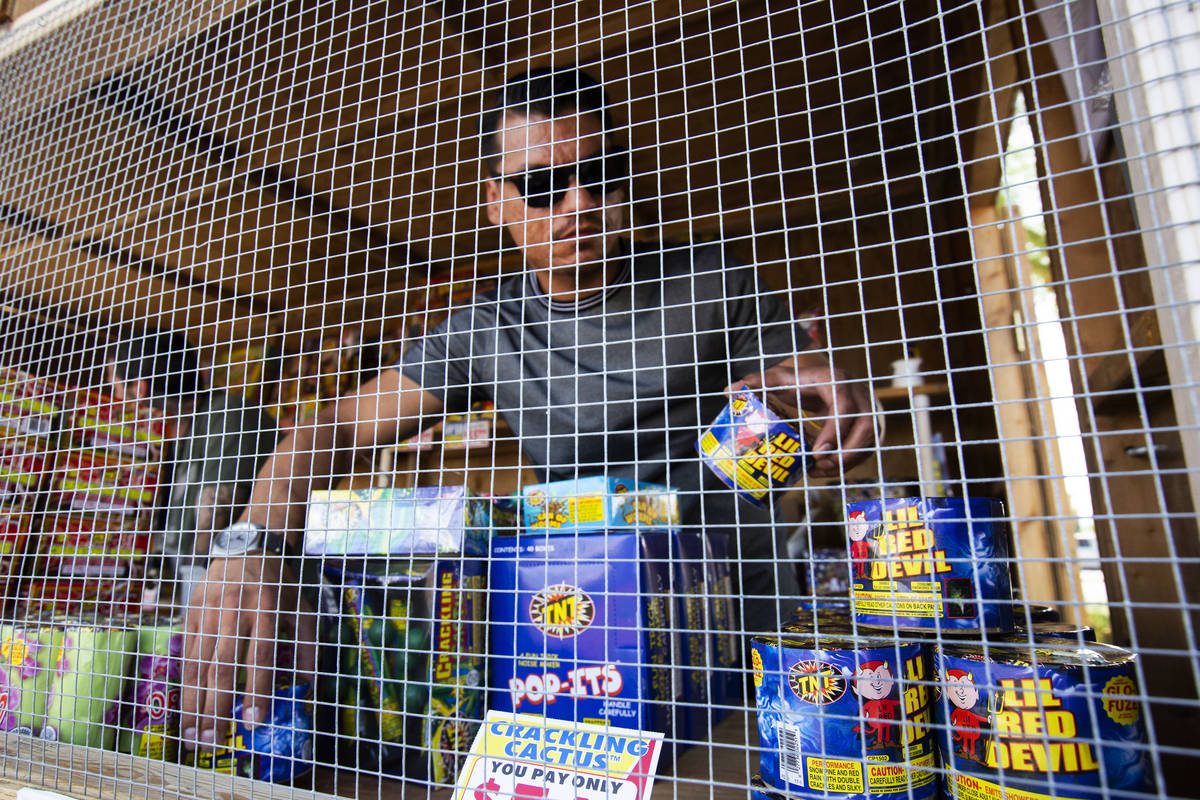 Floyd Ellis organizes fireworks at the front of the fireworks booth for Freedom House Sober Liv ...